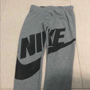 A grey girls Nike leggings